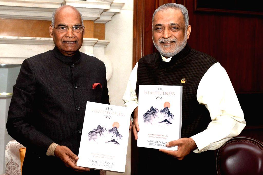 President Ram Nath Kovind unveils Kamlesh Patel's book 'The Heartfulness Way' in New Felhi. - Nath Kovind and Kamlesh Patel