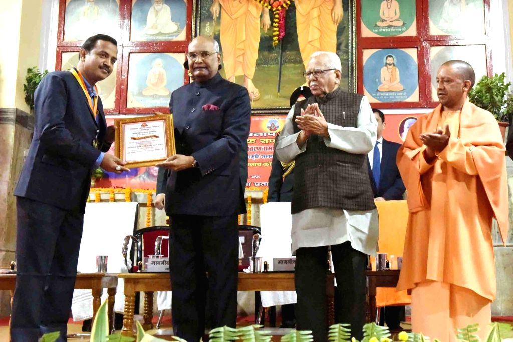 President Ram Nath Kovind, Uttar Pradesh Governor Ram Naik and Chief Minister Yogi Adityanath at the Founder's Week Celebration of Maharana Pratap Shiksha Parishad in Gorakhpur, Uttar ... - Yogi Adityanath and Nath Kovind