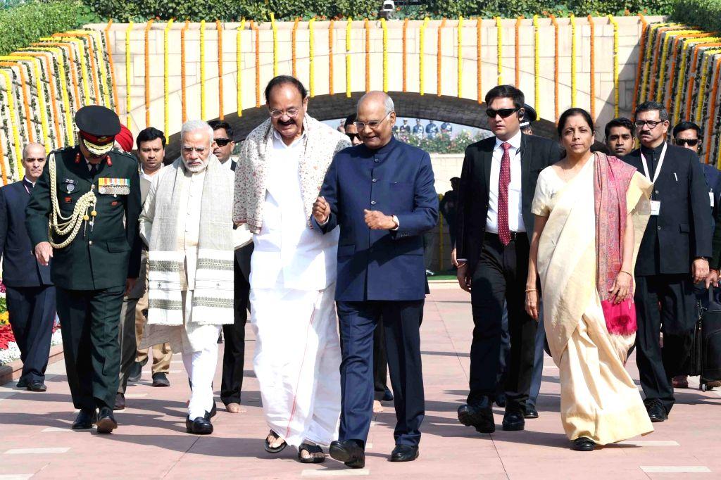 President Ram Nath Kovind, Vice President M. Venkaiah Naidu, Prime Minister Narendra Modi, Defence Minister Nirmala Sitharaman and other dignitaries pay tribute on the occasion of 70th ... - Narendra Modi, M. Venkaiah Naidu and Nath Kovind