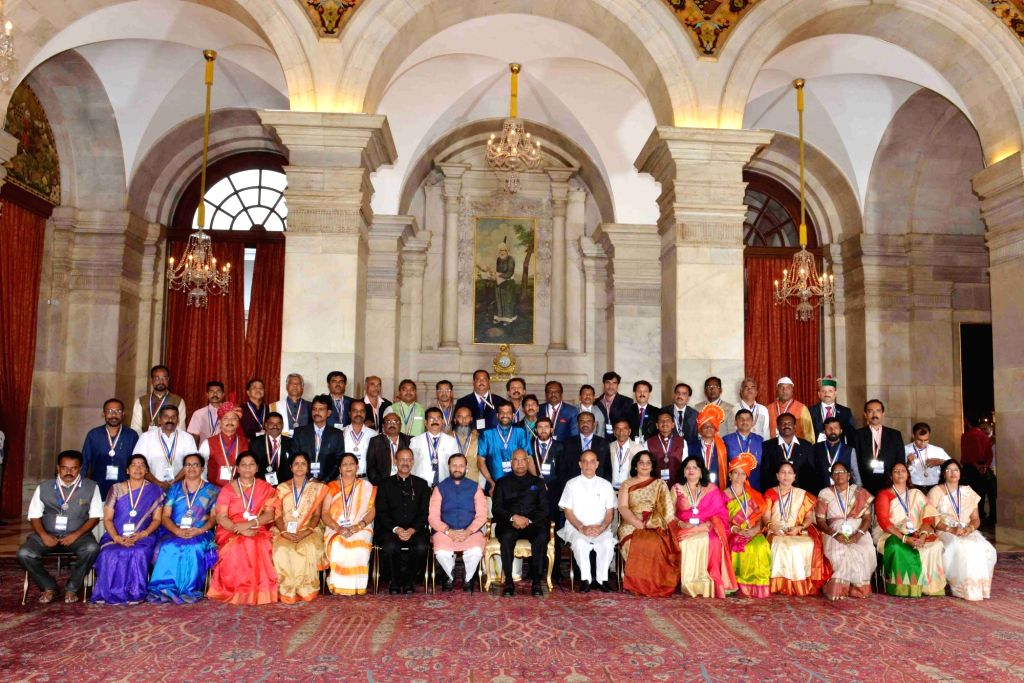 President Ram Nath Kovind with awardee teachers on Teacher's Day at Rashtrapati Bhavan, in New Delhi on Sept 5, 2017. Also seen Union Ministers Prakash Javadekar, Dr. Satya Pal Singh and ... - Prakash Javadekar, Nath Kovind and Satya Pal Singh