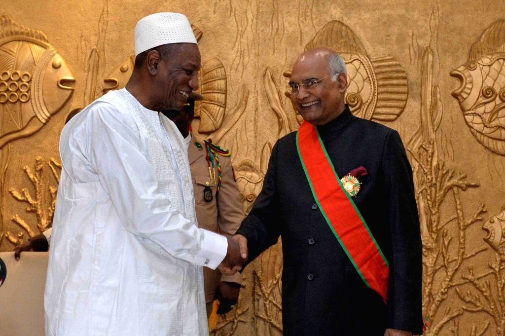President Ram Nath Kovind with Guinea President Alpha Cond?? during a banquet hosted in his honour by Conde, in Conakry on Aug 2, 2019. - Nath Kovind