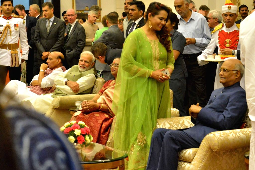 President Ram Nath Kovind with his daughter during the At Home reception on the occasion of 71st Independence Day Celebration at Rashtrapati Bhavan on Aug. 15, 2017. - Nath Kovind