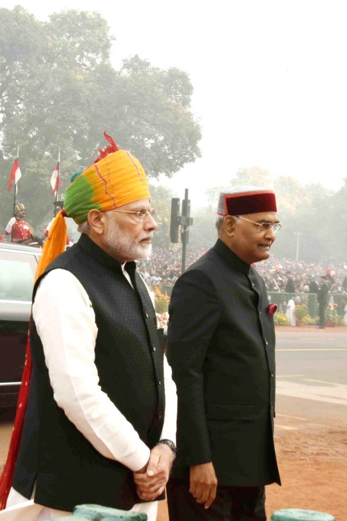 President Ram Nath Kovind with Prime Minister Narendra Modi after reaching the venue of Republic Day 2018 celebrations on Rajpath in New Delhi, on Jan 26, 2018. - Narendra Modi and Nath Kovind