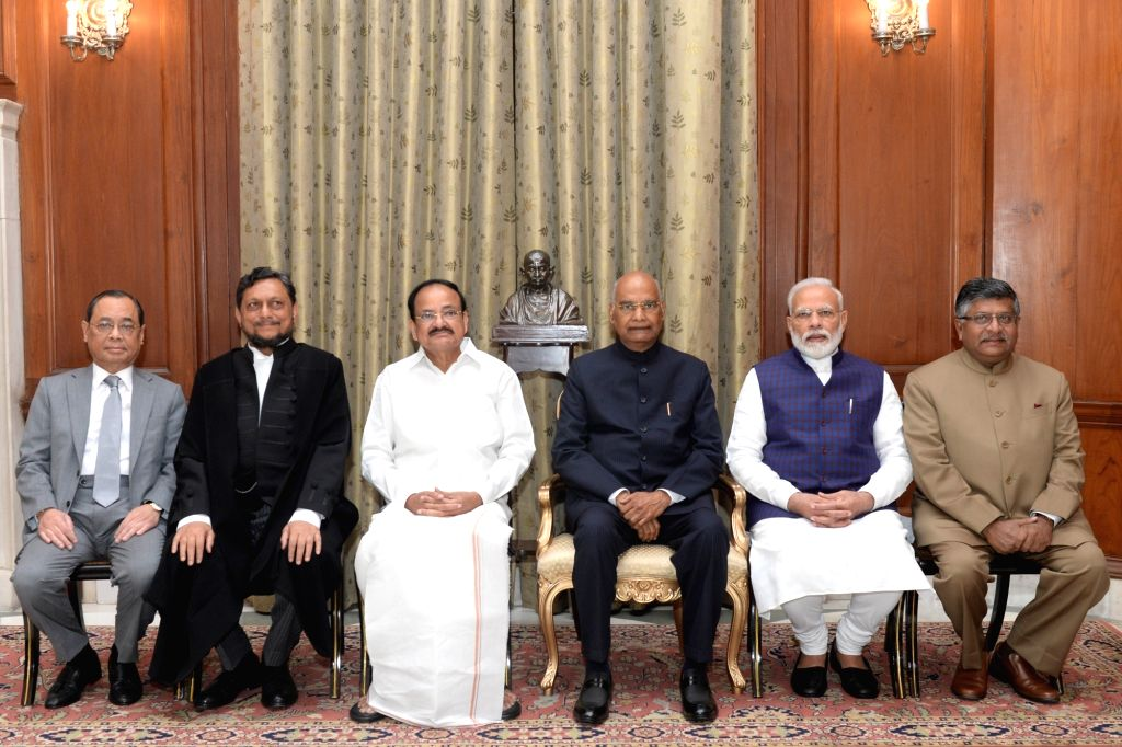 President Ram Nath Kovind with Vice President  M. Venkaiah Naidu, Prime Minister Narendra Modi,  Union Law and Justice Minister Ravi Shankar Prasad, outgoing Chief Justice of India Ranjan ... - Narendra Modi, M. Venkaiah Naidu and Nath Kovind