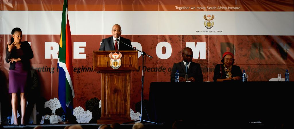 South Africa's President Jacob Zuma (2nd L) speaks during a celebration to commemorate the Freedom Day at the Union Buildings in Pretoria, South Africa, on April ...