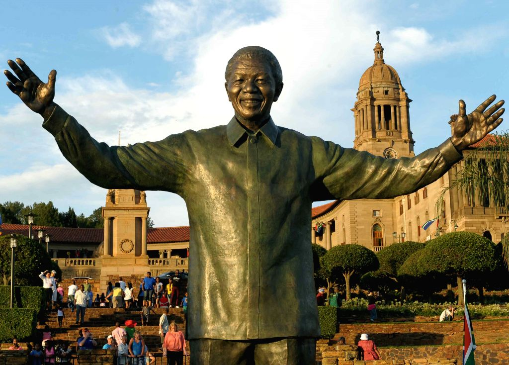 : PRETORIA, Dec. 17, 2013 (Xinhua/IANS)People visit the statue of former South African President Nelson Mandela at the Union Buildings in Pretoria Dec. 16, 2013. South African President Jacob ...