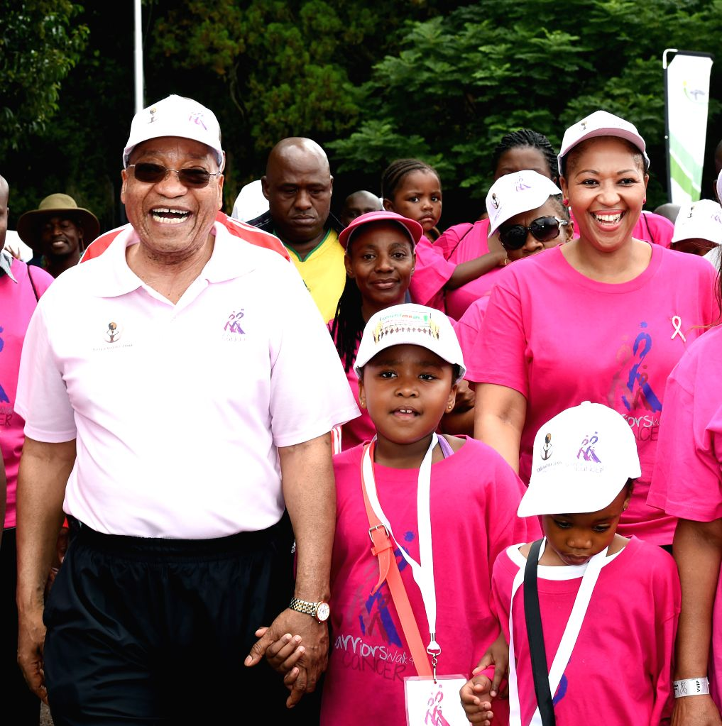 South Africa's President Jacob Zuma (1st L) and his wife Tobeka Madiba Zuma (1st R) attend the Warriors Walking for Cancer 2015 in Pretoria, South Africa, on Feb. ...