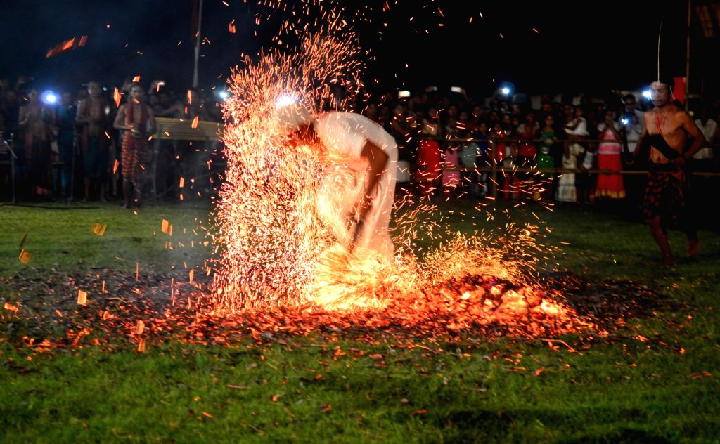 Priests belonging to the Rabha community run over burning charcoal during the Baikho festival in Dudhnai, Goalpara district of Assam on  June 9,  2017. The festival is celebrated for the ...