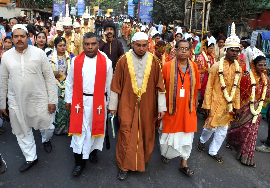Priests of during a mass marriage programme where couples following Hinduism, Islam and Christianity got married in Kolkata, on Feb 14, 2018.