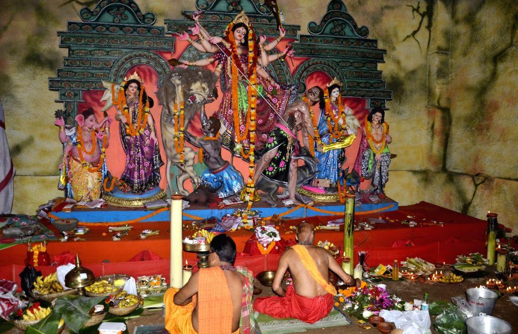 Priests offer prayers to goddess Durga on Maha Saptami in Guwahati on Oct 8, 2016.