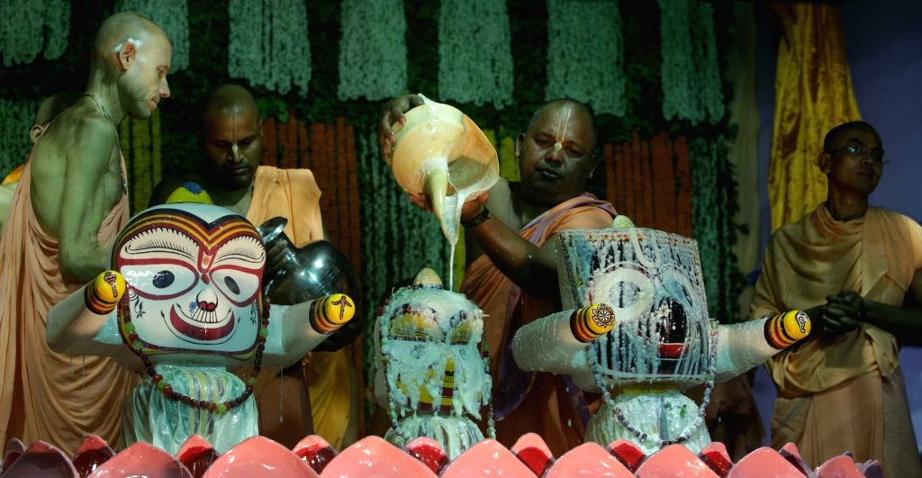 Priests perform rituals during Lord Jaganath's Snana Yatra at Iskon Temple in Kolkata on June 20, 2016.
