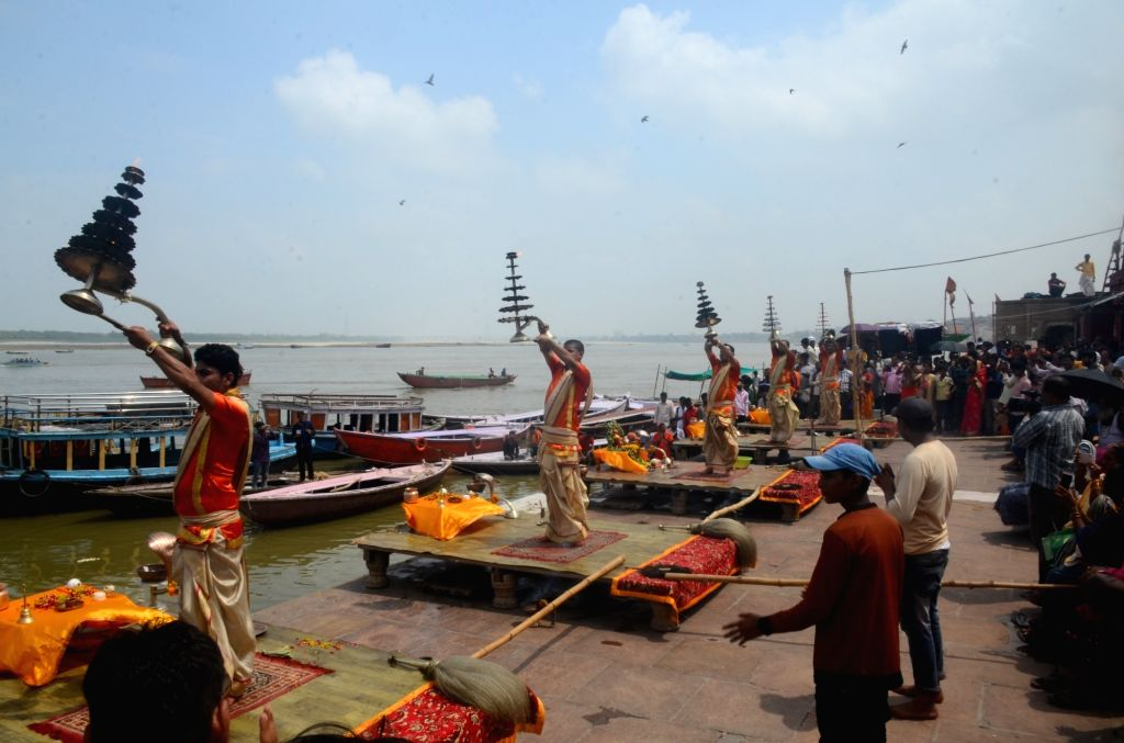 Priests performing daily Ganga aarti in the afternoon at Dashashwamedh Ghat in view of the lunar eclipse in Varanasi, on July 27, 2018. The Century's longest lunar eclipse or Chandra Grahan ...