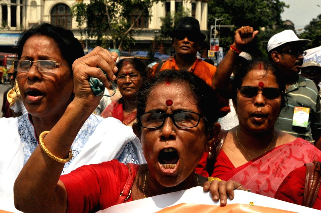 Primary school teachers stage a demonstration against West Bengal government in Kolkata on July 18, 2019.