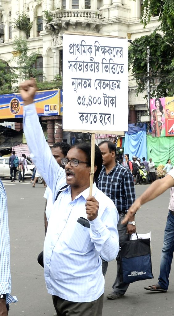 Primary teachers participate in a protest rally to press for their various demands, in Kolkata on Sep 27, 2019.
