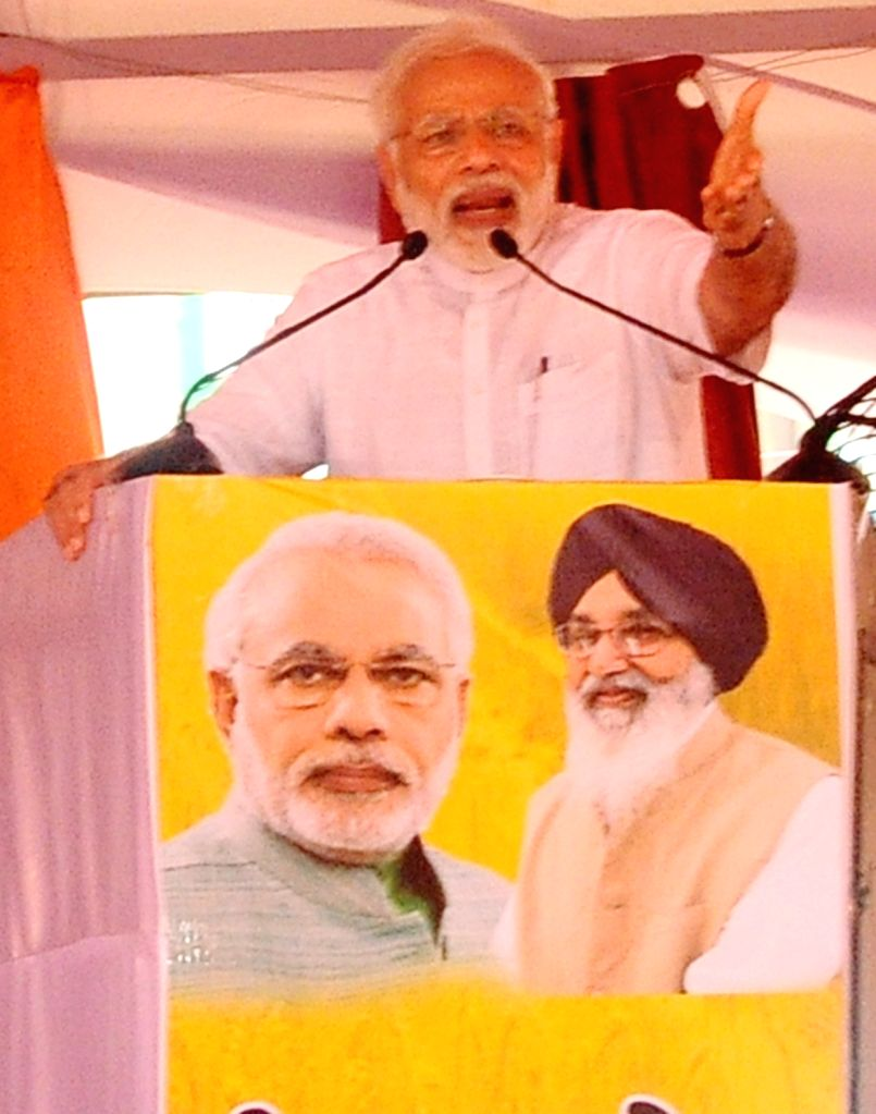 Prime Minister and BJP leader Narendra Modi addresses at 'Kisan Kalyan Rally'in Malout of Punjab's Muktsar district on July 11, 2018. - Narendra Modi