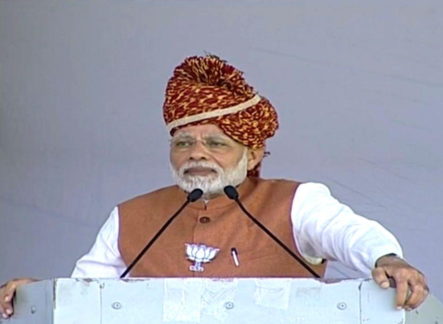 Prime Minister and BJP leader Narendra Modi addresses during a public meeting in Rajasthan's Jodhpur, on Dec 3, 2018. - Narendra Modi