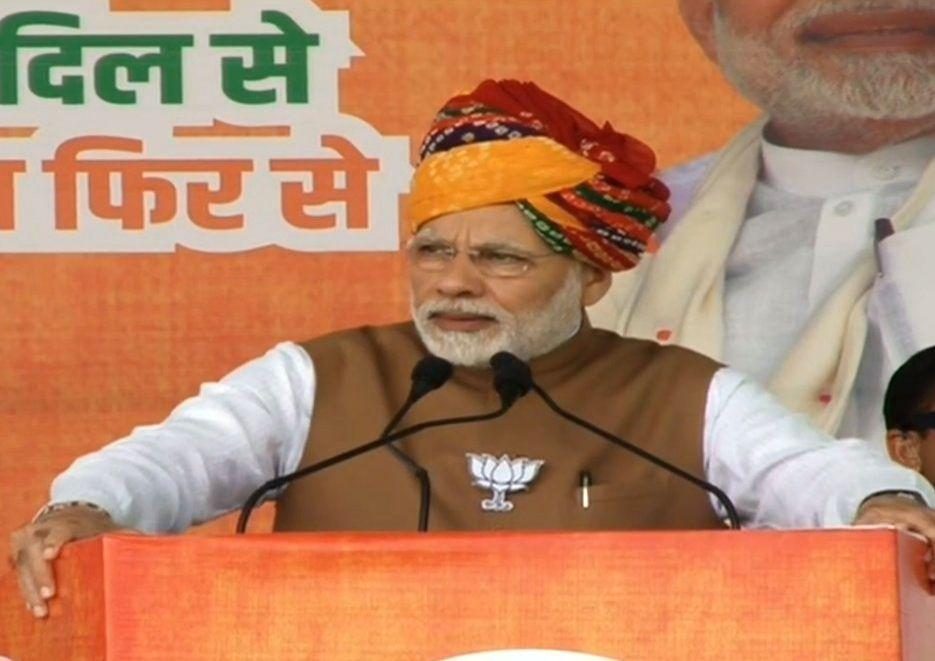 Prime Minister and BJP leader Narendra Modi addresses during a public meeting in Rajasthan's Hanumangarh, on Dec 4, 2018. - Narendra Modi