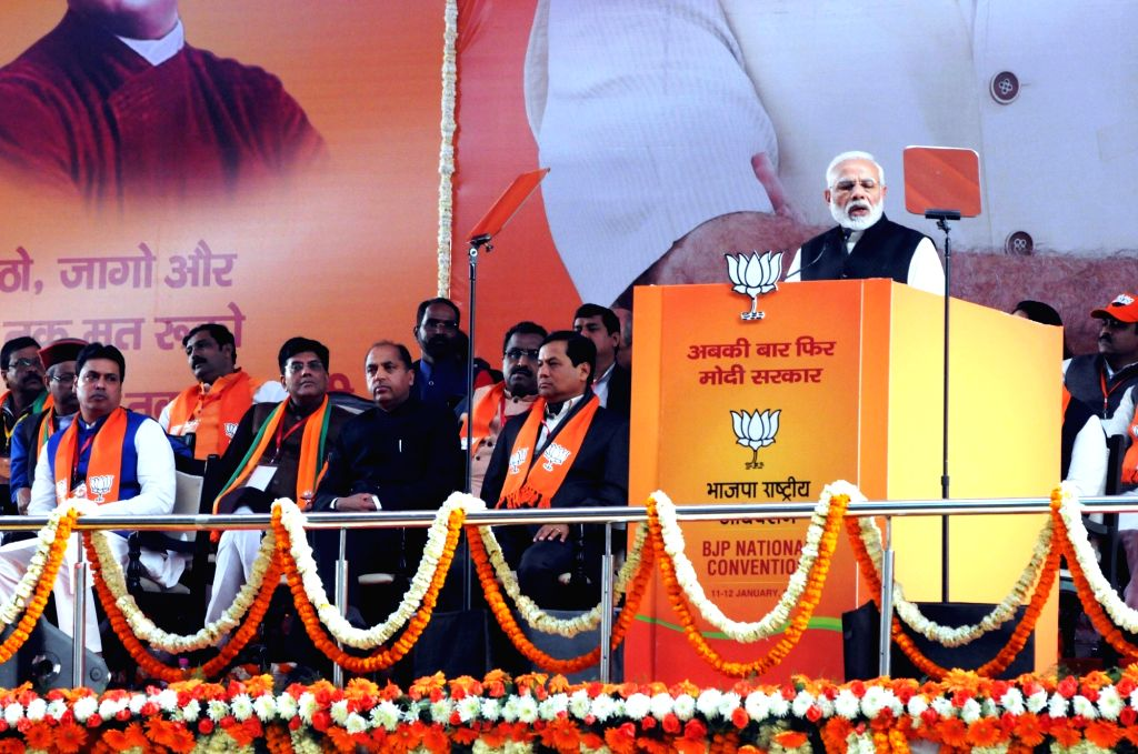 Prime Minister and BJP leader Narendra Modi addresses on the second day of the party's two-day long National Council meeting at Ramlila Maidan in New Delhi, on Jan 12, 2019. Also seen BJP ... - Narendra Modi and Biplab Kumar Deb