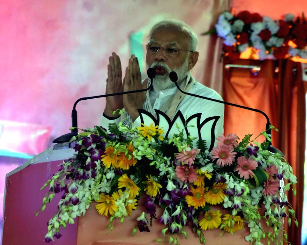 Prime Minister and BJP leader Narendra Modi addresses party workers, in Varanasi, on April 26, 2019. - Narendra Modi