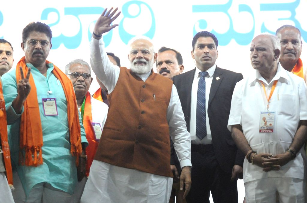 Prime Minister and BJP leader Narendra Modi with party's Karnataka unit chief during a party rally in Hubballi of Karnataka on Feb 10, 2019. - Narendra Modi