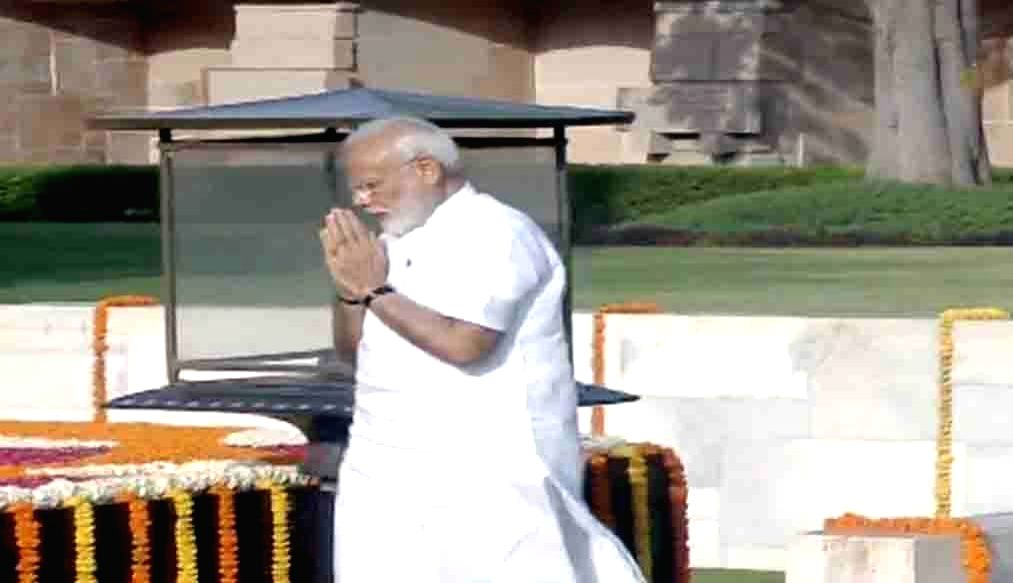 Prime Minister-elect Narendra Modi visits the memorials of Mahatma Gandhi and Atal Bihari Vajpayee ahead of his swearing in for a second term, in New Delhi on May 30, 2019. - Narendra Modi and Atal Bihari Vajpayee