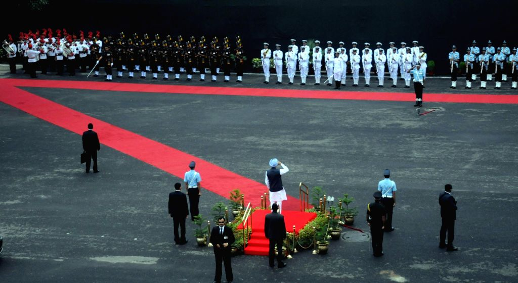 Prime Minister Manmohan Singh inspecting the guard of honor on his arrival at Red Fort in Delhi to address the nation as India celebrates its Independence Day on August 15, 2013. India commemorates ..