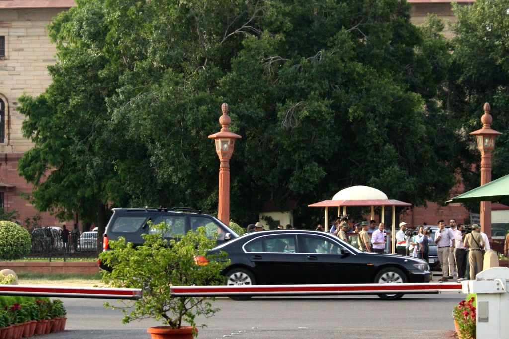 Prime Minister Manmohan Singh leaves after the last cabinet meeting of UPA-II government in New Delhi on May 13, 2014. - Manmohan Singh