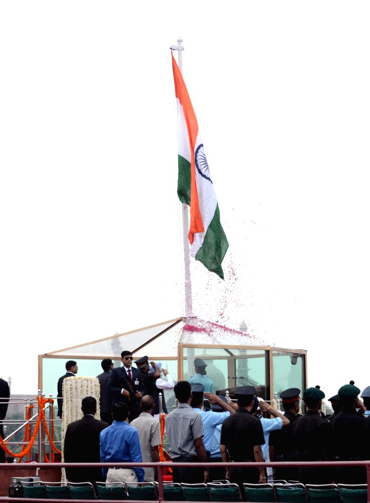 Prime Minister Manmohan Singh unfurling the tricolour flag at the ramparts of Red Fort on the occasion of 67th Independence Day in Delhi on August 15, 2013. (Photo::: IANS)