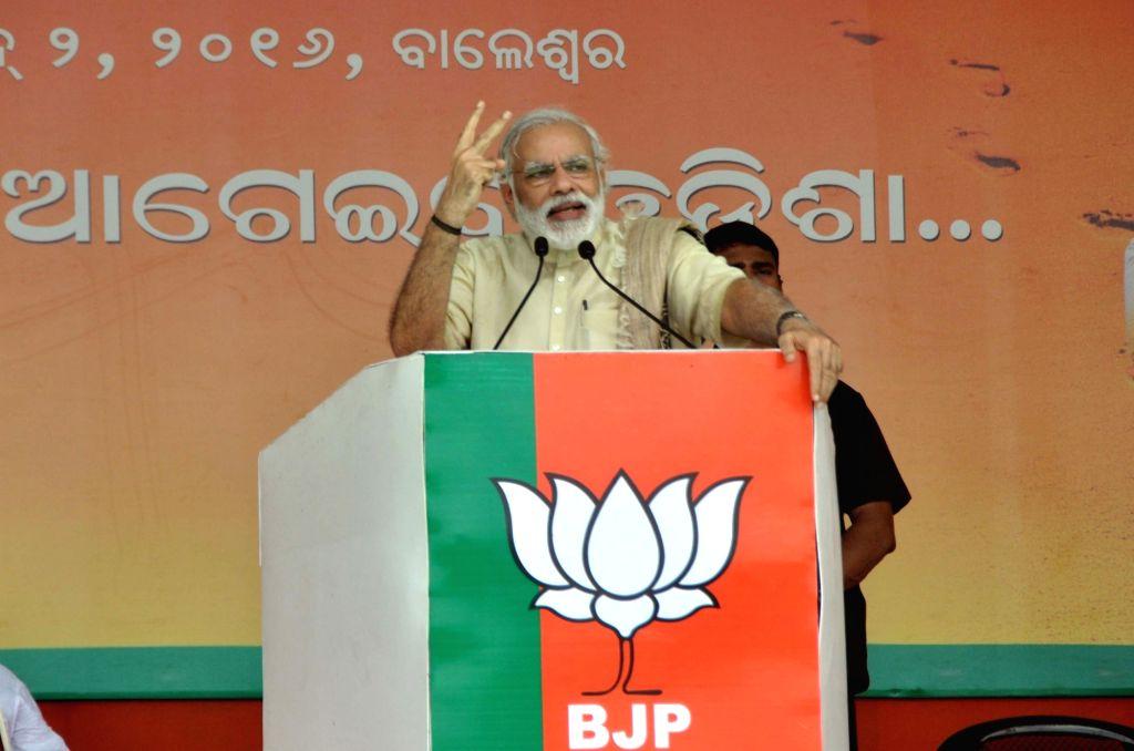 Prime Minister Naredra Modi addresses a BJP rally in Balasore district of Odisha on June 2, 2016. - Naredra Modi