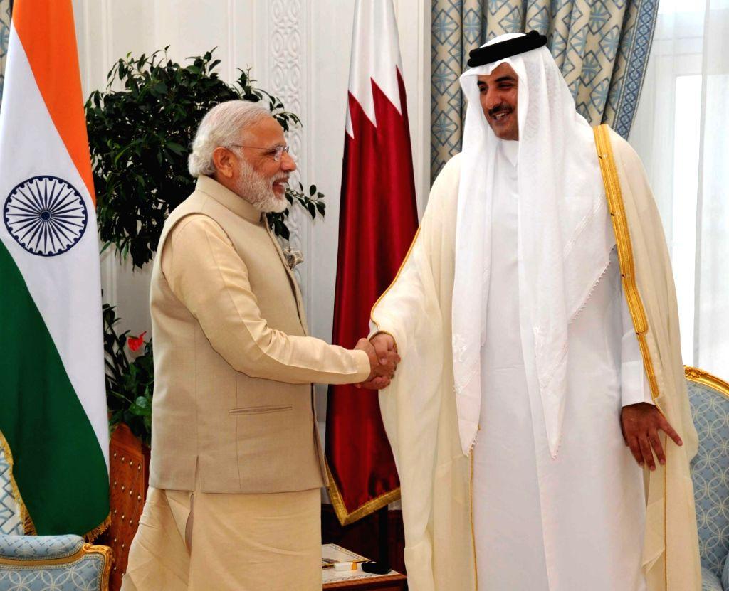 Prime Minister Narendra Mod with Emir of Qatar Sheikh Tamim Bin Hamad Al Thani. (File Photo: IANS) - Narendra Mod