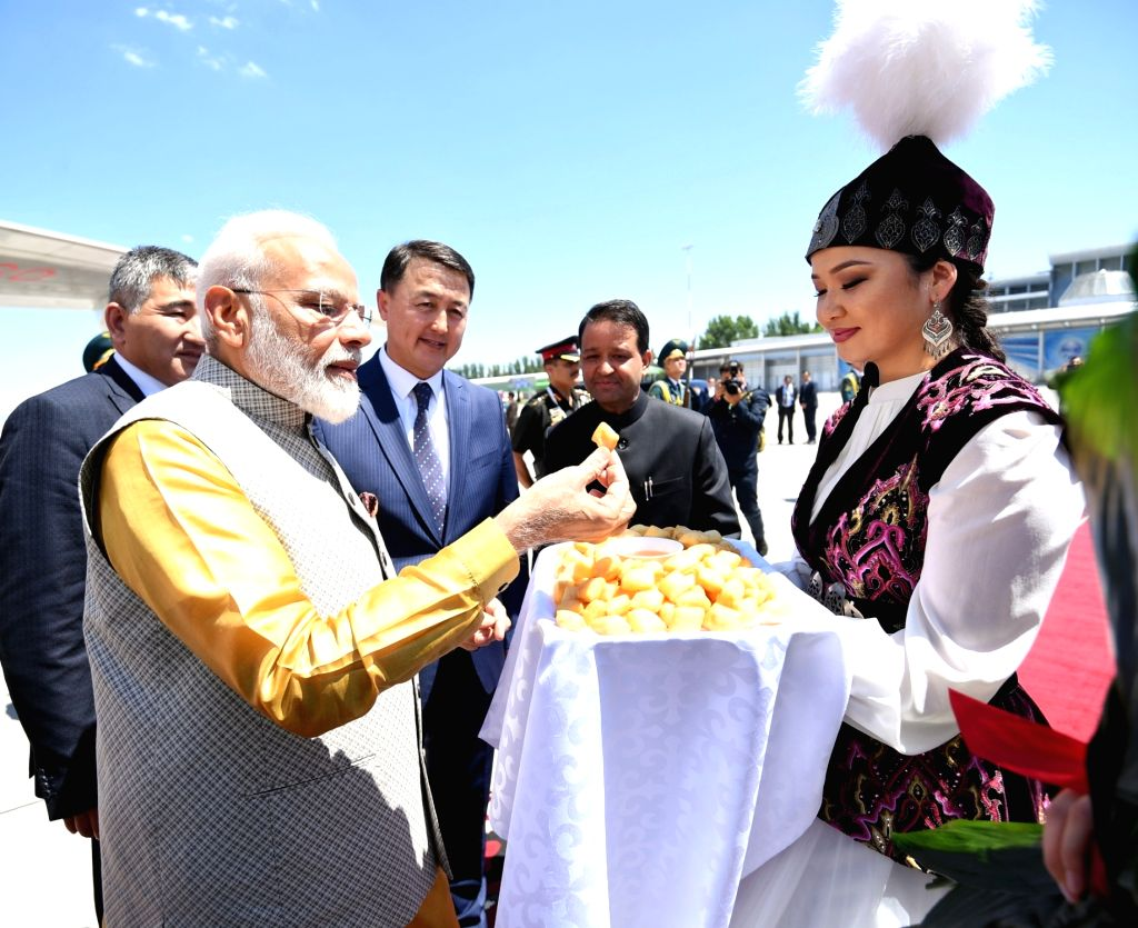 Prime Minister Narendra Modi accompanied by Kyrgyzstan Prime Minister Mukhammedkalyi Abylgaziev, receives a warm welcome on his arrival at Bishkek, Kyrgyzstan to attend the meeting of the ... - Narendra Modi