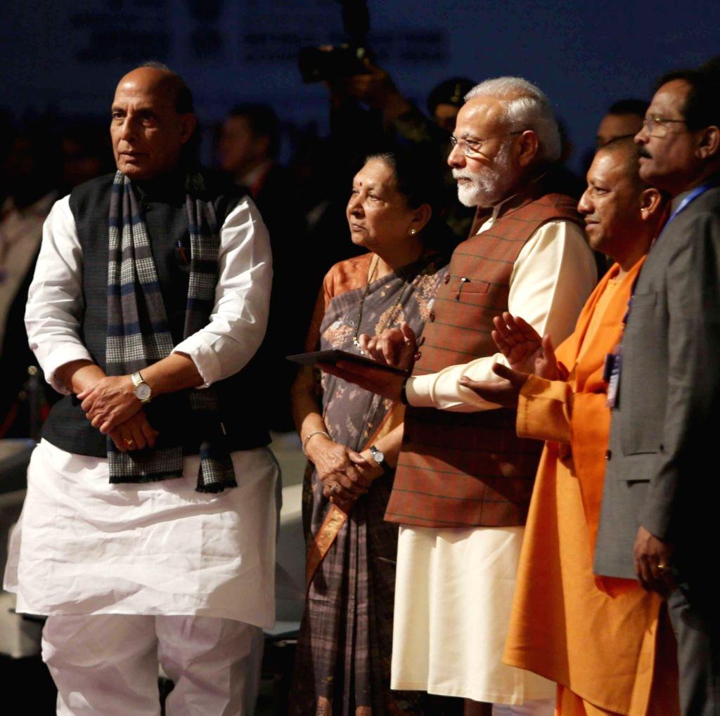 Prime Minister Narendra Modi accompanied by Defence Minister Rajnath Singh, MoS Defence Shripad Yesso Naik, Uttar Pradesh Governor Anandiben Patel and Chief Minister Yogi Adityanath, ... - Narendra Modi, Rajnath Singh and Anandiben Patel