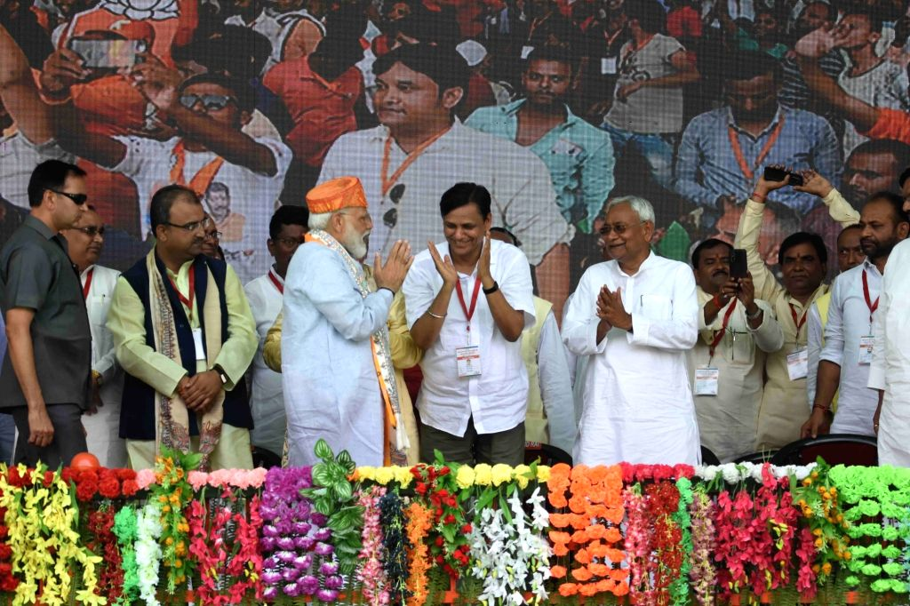 Prime Minister Narendra Modi accompanied by Bihar Chief Minister Nitish Kumar, during a public rally in Darbhanga, Bihar, on April 25, 2019. - Narendra Modi and Nitish Kumar