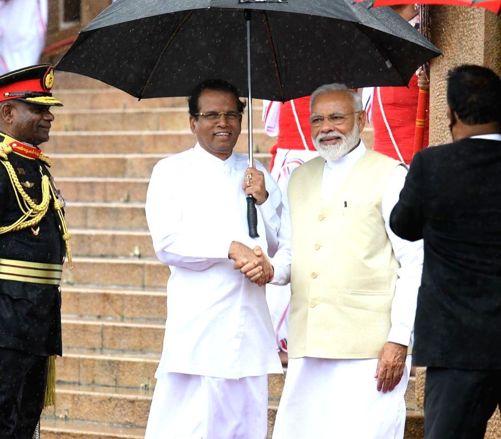 Prime Minister Narendra Modi accompanied by Sri Lanka President Maithripala Sirisena, at his ceremonial reception in Colombo, Sri Lanka on June 9, 2019. - Narendra Modi