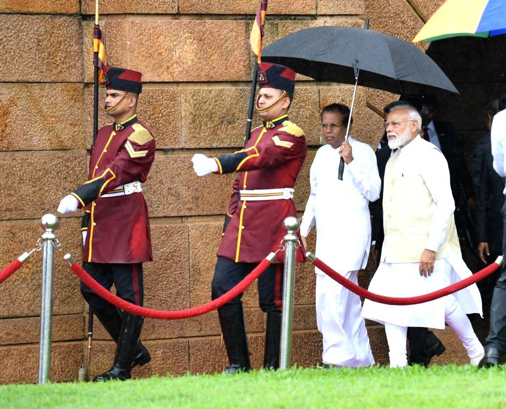 Prime Minister Narendra Modi accompanied by Sri Lanka President Maithripala Sirisena, during his ceremonial reception in Colombo, Sri Lanka on June 9, 2019. - Narendra Modi