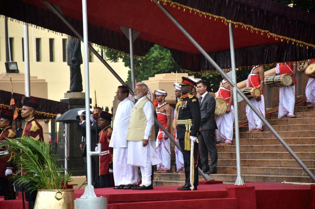 Prime Minister Narendra Modi accompanied by Sri Lanka President Maithripala Sirisena, receives the Guard of Honour at his ceremonial reception in Colombo, Sri Lanka on June 9, 2019. - Narendra Modi