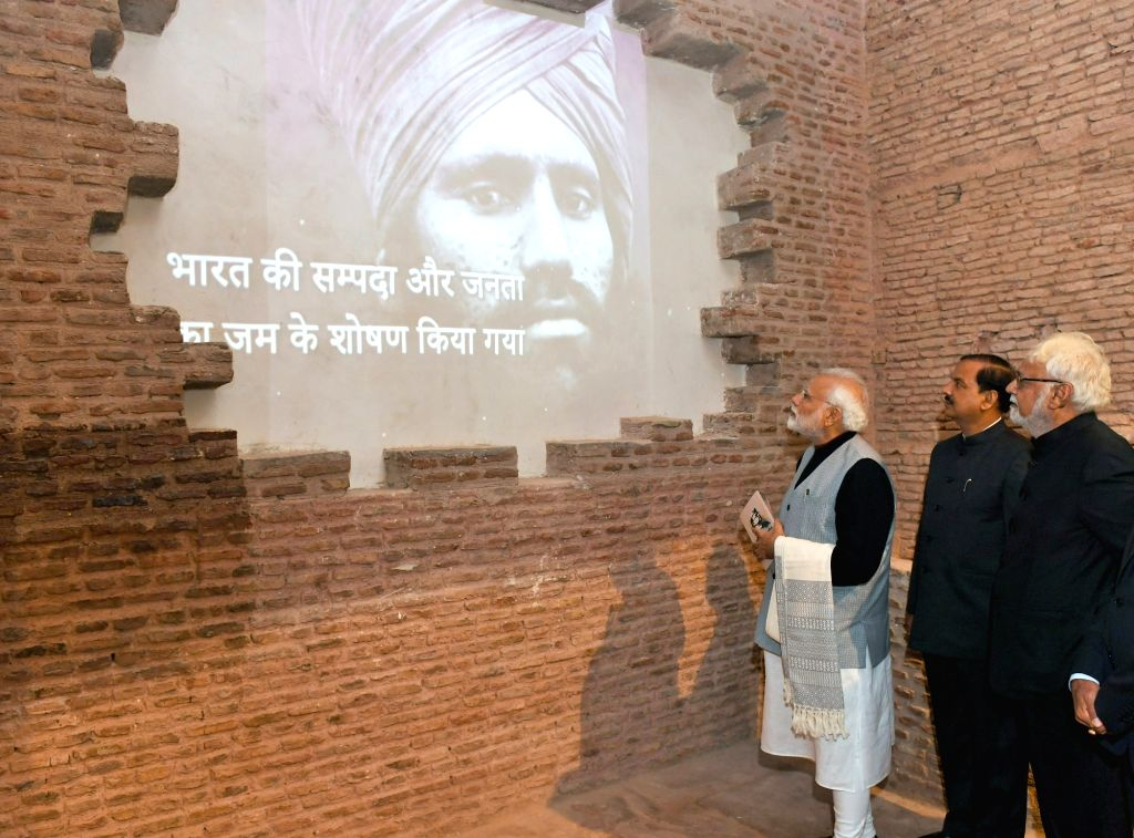 Prime Minister Narendra Modi accompanied by Union MoS Culture Mahesh Sharma, visits the Yaad-e-Jallian Museum at Red Fort in New Delhi, on Jan 23, 2019. - Narendra Modi and Mahesh Sharma