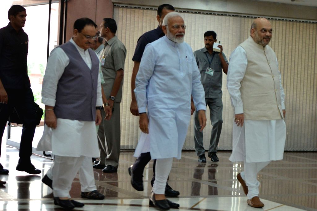 Prime Minister Narendra Modi accompanied by Union Home Minister Amit Shah and BJP National Working President J.P. Nadda, arrives to inaugurate the two-day training programme 'Abhyas Varga' ... - Narendra Modi and Amit Shah