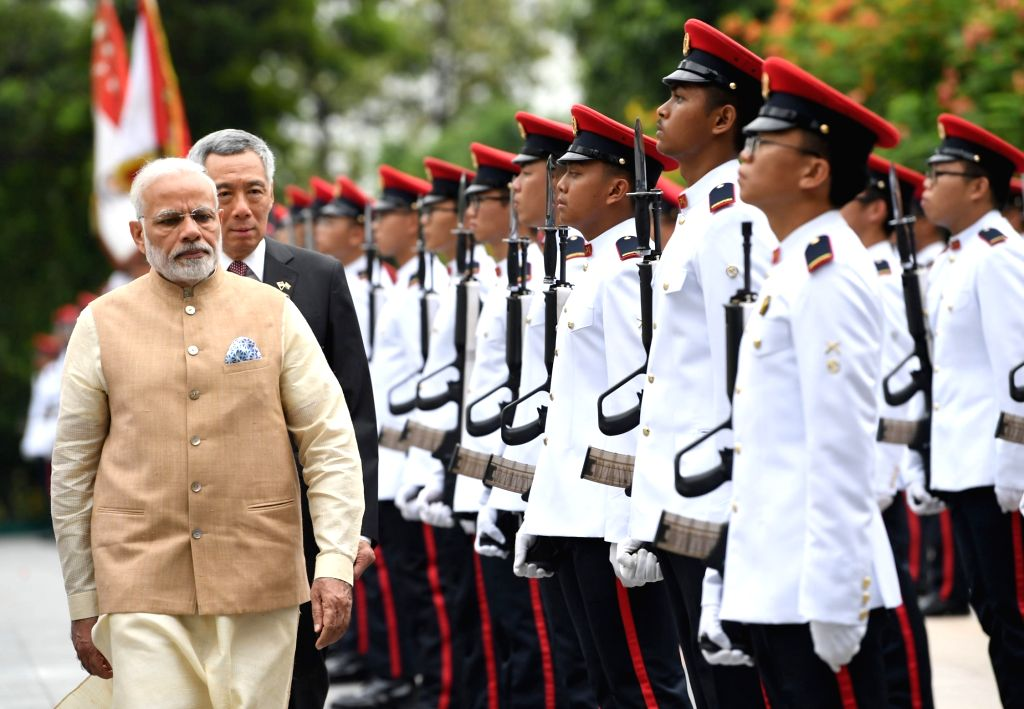 Prime Minister Narendra Modi accorded ceremonial welcome on his arrival, at Istana - Presidential Palace, in Singapore on June 01, 2018. The Prime Minister of Singapore Lee Hsien Loong is ... - Narendra Modi
