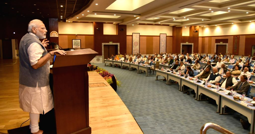 Prime Minister Narendra Modi addresses Secretaries to the Government of India at Pravasi Bharatiya Kendra, in New Delhi on Oct 27, 2016. - Narendra Modi