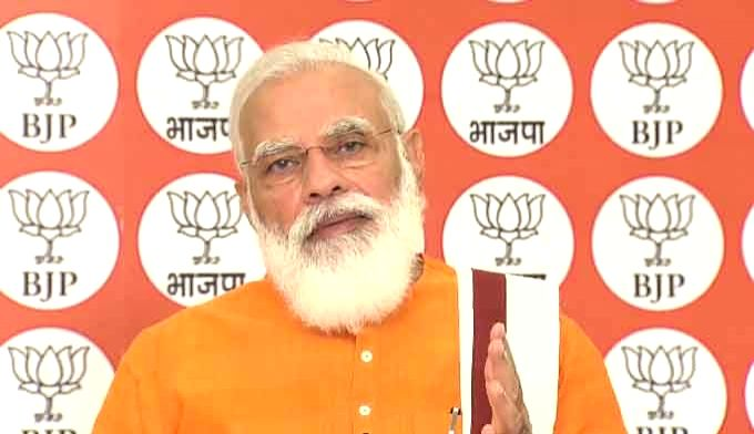 Prime Minister Narendra Modi addresses a programme organised by the BJP to commemorate Bharatiya Jana Sangh chief Deendayal Upadhyaya's birth anniversary, via video conferencing in New ... - Narendra Modi