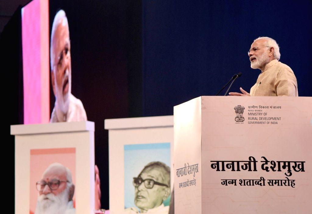 Prime Minister Narendra Modi addresses a gathering to commemorate the birth centenary celebrations of Nanaji Deshmukh at Indian Agricultural Research Institute (IARI) in New Delhi on Oct ... - Narendra Modi and Nanaji Deshmukh