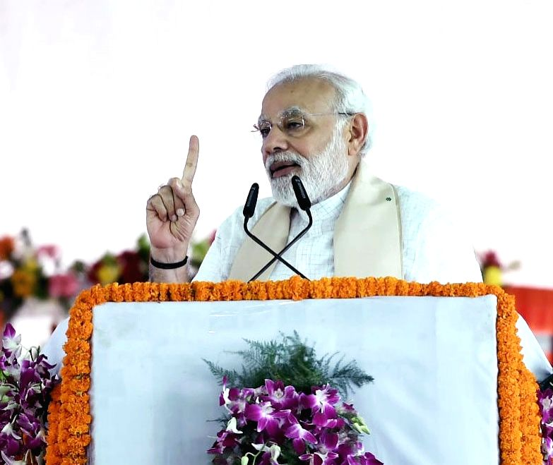 Prime Minister Narendra Modi addresses a gathering at a programme where he inaugurated Bansagar canal, 100 Pradhan Mantri Jan Aushadi Kendras and a bridge over the Ganga river and laid the ... - Narendra Modi