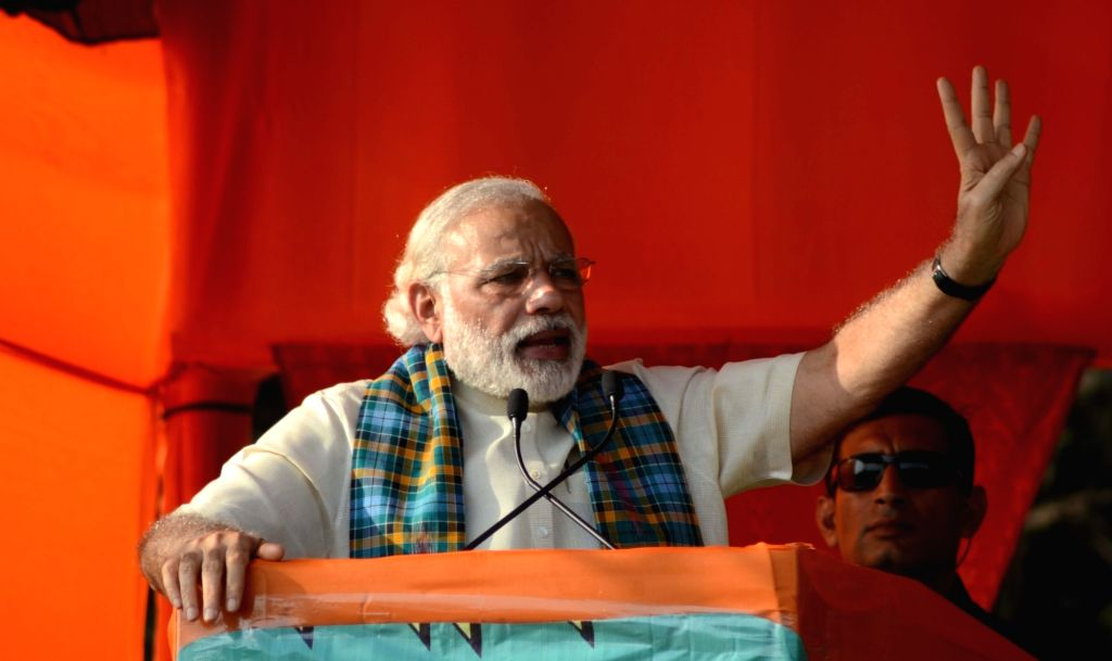 Prime Minister Narendra Modi addresses a BJP rally in Basirhat of West Bengal on April 21, 2016. - Narendra Modi
