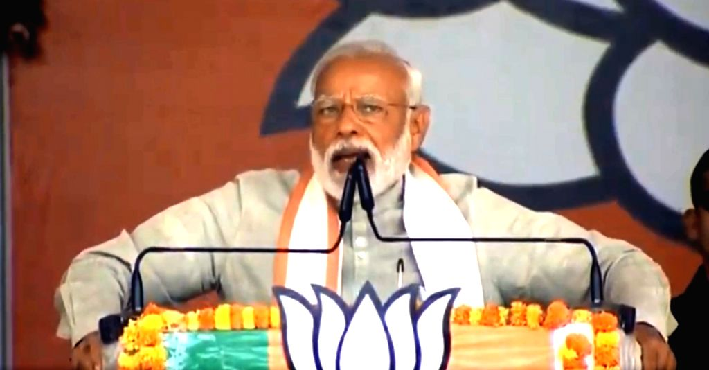 Prime Minister Narendra Modi addresses a BJP rally in Uttar Pradesh's Kushinagar on May 12, 2019. - Narendra Modi