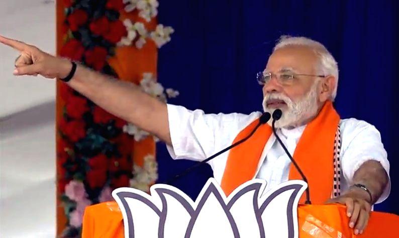Prime Minister Narendra Modi addresses a public rally in Gujarat's Songadh, on April 10, 2019. - Narendra Modi