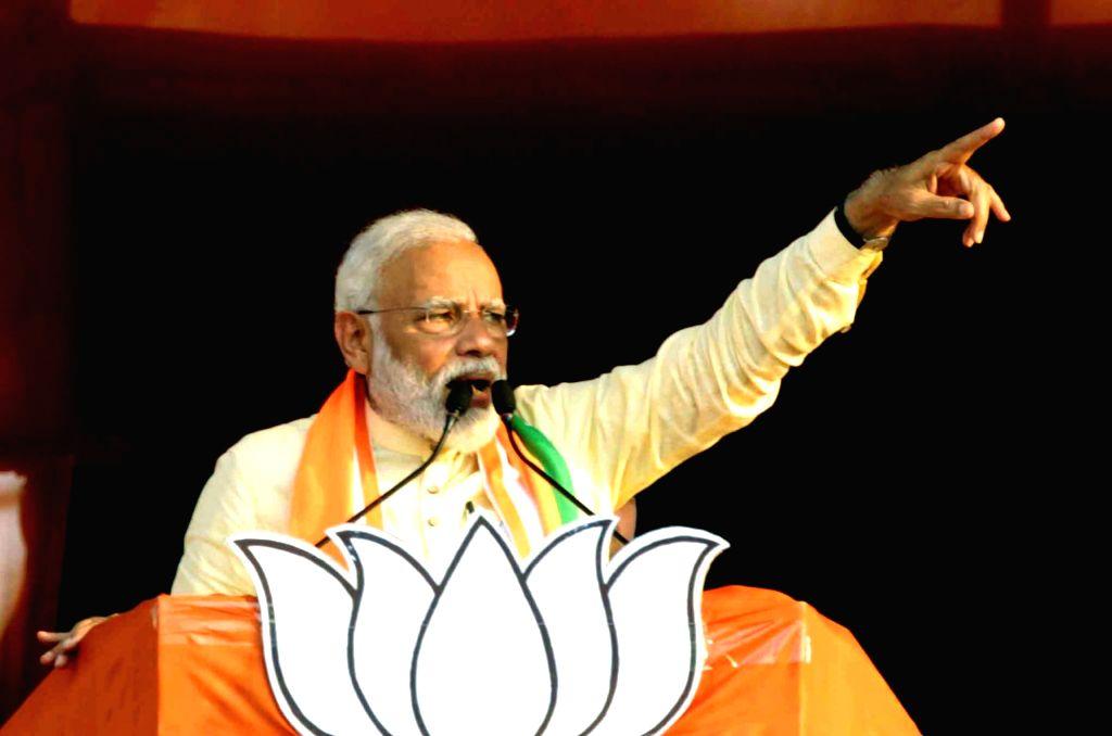 Prime Minister Narendra Modi addresses a public rally in Taherpur, West Bengal on April 24, 2019. - Narendra Modi