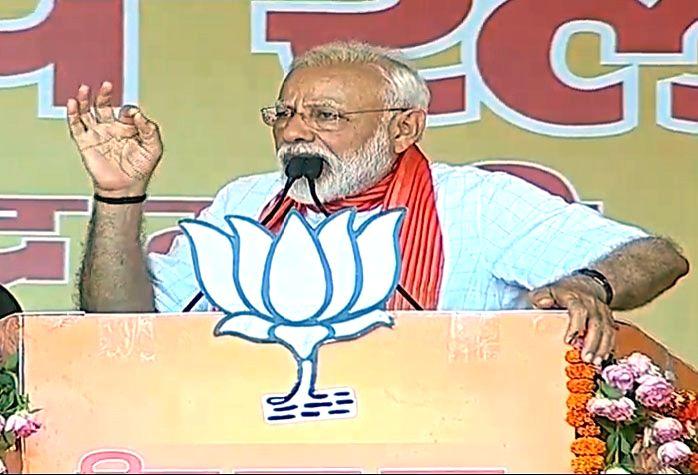 Prime Minister Narendra Modi addresses a public rally in Uttar Pradesh's Hardoi, on April 27, 2019. - Narendra Modi