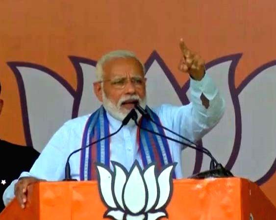Prime Minister Narendra Modi addresses a public rally in Pratapgarh, UP on May 4, 2019. - Narendra Modi