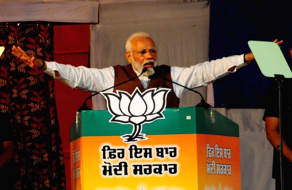 Prime Minister Narendra Modi addresses a public rally ahead of 2019 Lok Sabha elections, in Punjab's Hoshiarpur on May 10, 2019. - Narendra Modi